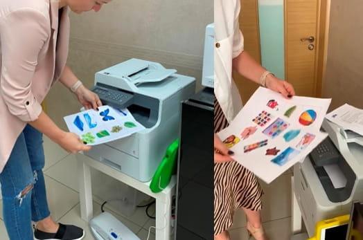 Женщина печатает учебные материалы на MFC-L3550CDW
