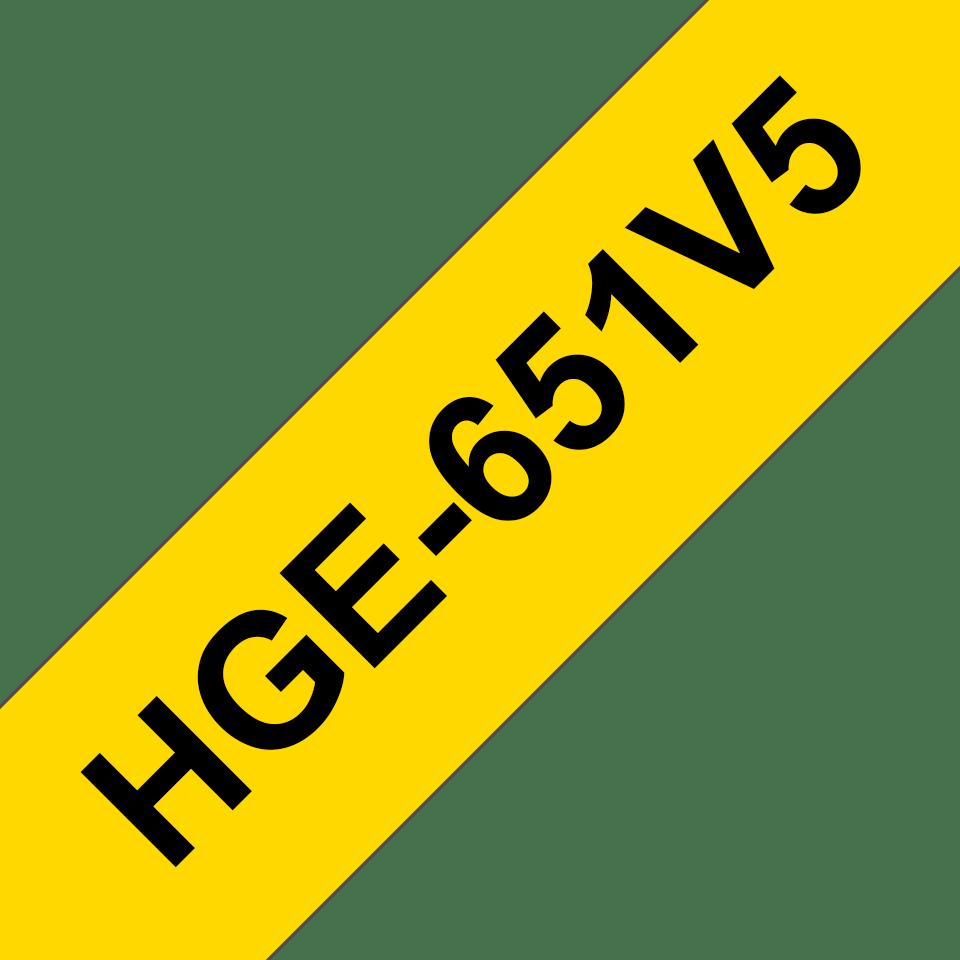 Brother HGe651V5: оригинальная кассета с лентой для печати наклеек черным на желтом фоне, ширина: 24 мм.