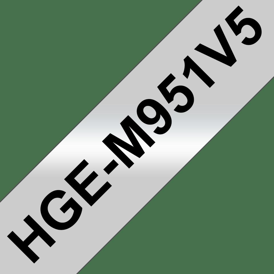 Brother HGeM951V5: оригинальная кассета с лентой для печати наклеек черным на матовом серебристом фоне, ширина: 24 мм.