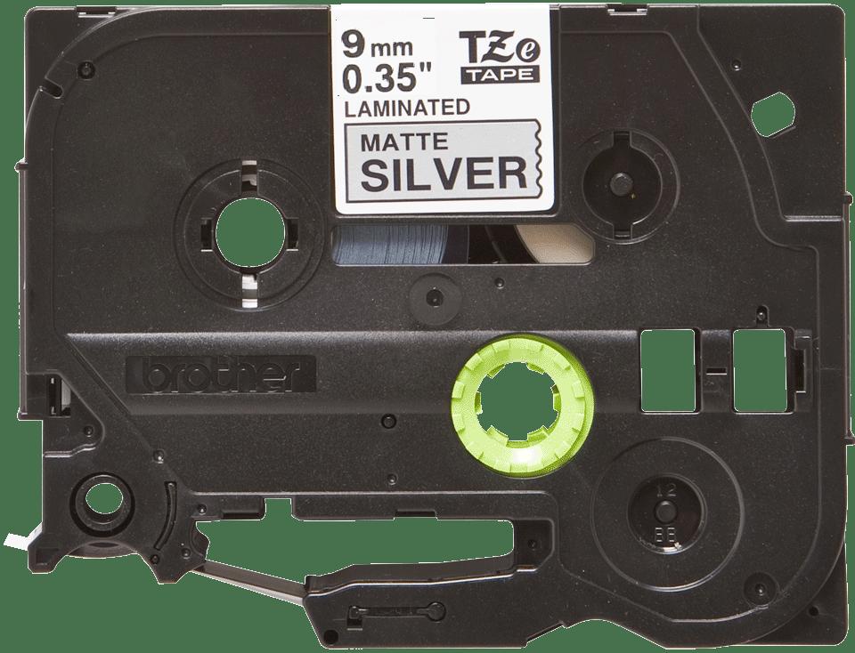 Brother TZeM921: оригинальная кассета с лентой для печати наклеек черным на матовом серебристом фоне, ширина: 9 мм.