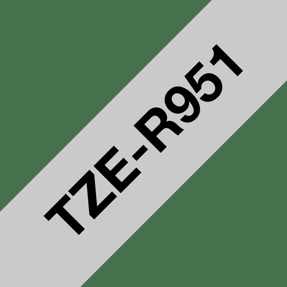 Оригинальная кассета с тканевой лентой TZe-R951 -черный на серебряном, ширина 24 мм. 3